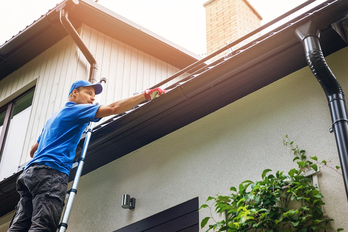 keep gutters clean to protect properties in winter